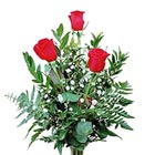 Simply beautiful. Three elegant roses with greens and accents displayed in a tasteful bud vase. When ordering please indicate color preference.