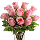 Send a message of gratitude, appreciation, admiration, or caring with one dozen beautiful pink roses designed with fresh greens and delivered in an attractive glass vase. Great for sweethearts, moms, friends, new baby girls, birthdays, get well, anniversaries, and expressions of sympathy. Same-day and next-day florist delivery in the USA and Canada.