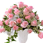 Send love, hope, and comfort with this stunning bouquet of pretty pink roses and carnations designed with fresh greens, delicate floral accents, and a sheer ribbon to express your heartfelt sympathy and support. Soft, stylish, and feminine. Appropriate for wakes, funerals, and memorial services. FTD florist delivery in the USA and Canada.