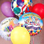 A festive assortment of mylar and latex balloons with a birthday theme for a greeting that's sure to get noticed.