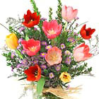 This pretty vased bouquet features fresh cut tulips in assorted Spring colors with greens and delicate accents. Great for almost any occasion -- or just to brighten someone's day. Generally available February through mid-May.