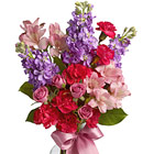 Say ?Congratulations,? ?Thanks,? or ?Thinking of You? with this thoughtful bouquet of pretty pink, hot pink, and lavender blooms delivered in a quality glass vase. Featured flowers include spray roses, alstroemeria, miniature carnations, stock, or similar seasonal favorites. Just right! Same day and next day florist delivery in the USA and Canada.
