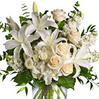 A beautiful combination of fresh garden lilies, roses, hydrangea, stock, or similar fancy favorites, in soft white, light pink or peach tones, designed and delivered in a classic glass vase to express your love and caring. A symbol of hope, purity, appreciation and comfort. Professional florist design and delivery throughout the USA and Canada.