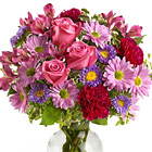 Warm someone's heart with this pretty vased bouquet in soft pink, purple, and laveder hues. Featured flowers include roses, alstroemeria, carnations, asters, daisy poms, or similar blooms. Soft, feminine, and full or beauty. Professional florist delivery throughout the USA and Canada.