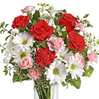 Make someone's heart skip a beat with this popular design of fresh roses, carnations, daisy poms, miniature carnations, baby's breath, or similar seasonal favorites, in pretty red, white, and pink tones. Great for friends, sweethearts, and Valentine's, too! Designed and delivered in a clear glass vase. Same day and next day florist delivery.