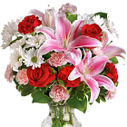 It's easy to say 'I Love You' with this heavenly bouquet of Oriental lilies, roses, carnations, daisies, and more! Designed and delivered in a clear glass vase. Popular for lave, annivesaries, birthdays, or any heartfelt expression. USA and Canada florist delivery.