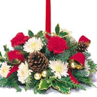 A classic holiday candle bouquet in traditional Christmas colors with all the accents. Great for a coffee table, welcome table, or intimate dining room centerpiece. Generally available after Thanksgiving through December.