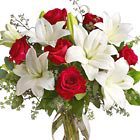 Express your love with this stunning combination of velvety red roses and garden-fresh lilies designed with fresh foliage in a classic glass vase. A beautiful choice for love, romance, anniversaries, Valentine?s, or any heartfelt expression of caring. Same day and next day delivery available in the USA and Canada.
